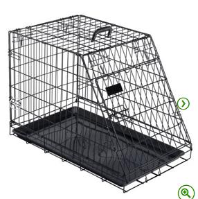 anderledes hundebur transport. Produceret i mørkt metal. Plastbund i buret. Let og billigt.